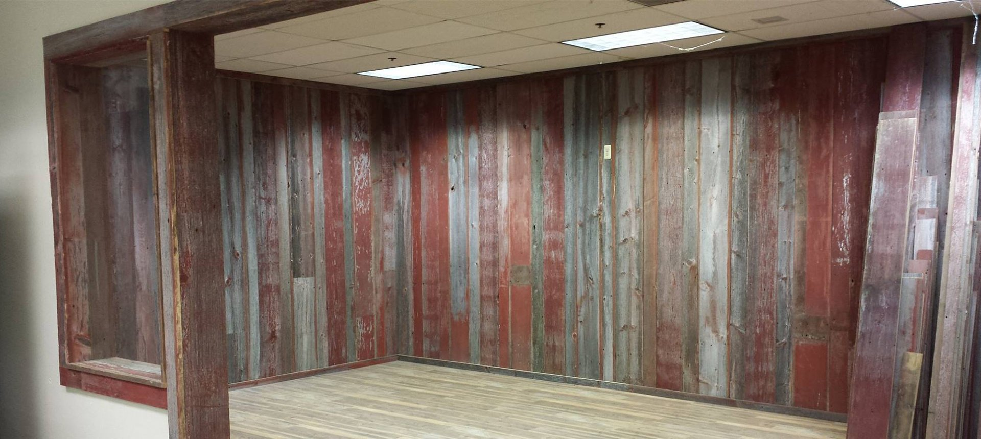 The best reclaimed barn wood in north america for Recycled wood siding